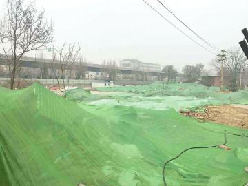 工业南路西端建筑垃圾已覆盖